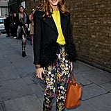 Olivia plays to fashion whimsy in Topshop floral pants, a citrus-hued tee and a pair of leopard print Mulberry heels while attending the Unique show at London Fashion Week.