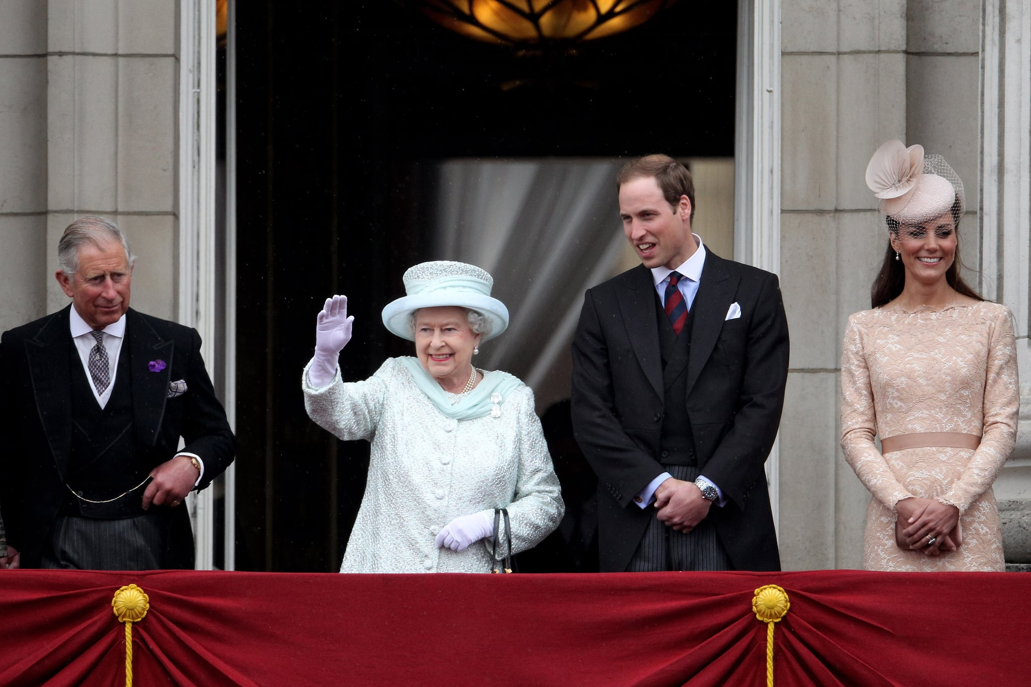 The queen and her family waved to people from the balcony for Queen on balcony