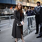 Jessica Chastain arrived at the Calvin Klein show in a gorgeous gray coat and classic pumps.