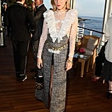 Chloë Sevigny opted to pair her high-slit skirt with a white sheer ruffled top.