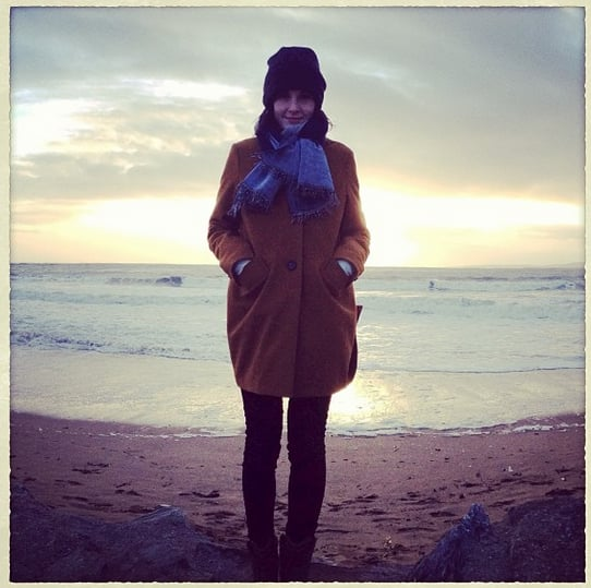 Michelle Dockery ditched her Downton Abbey wardrobe to bundle up at the beach. Source: Instagram user theladydockers