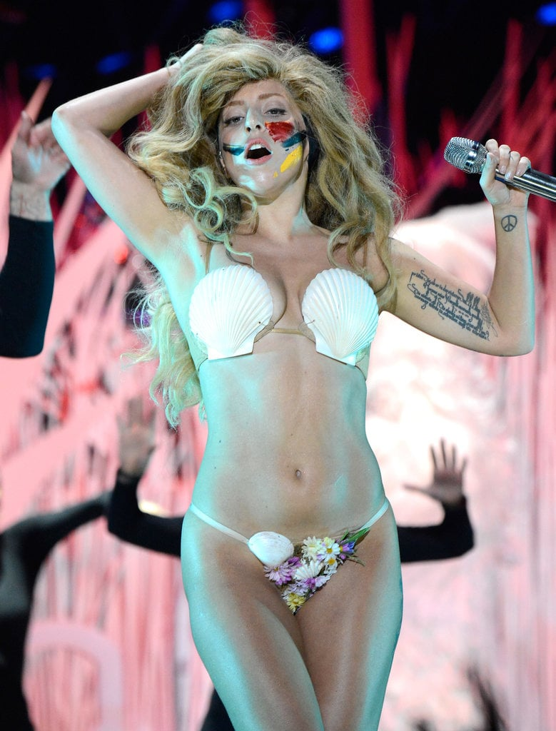 "Lady Gaga stripped to a seashell bra during her performance of ""Applause,"" which opened the MTV VMAs in 2013."