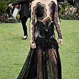 Kristen's Marchesa gown featured sheer insets at the sleeves and bodice and a lacy, see-through skirt.