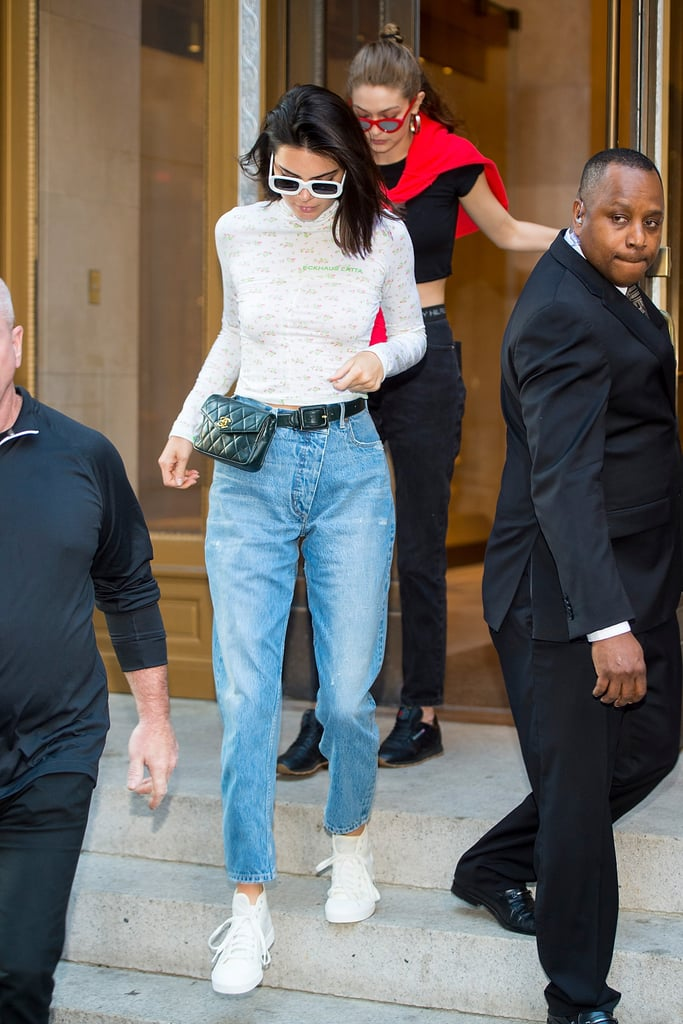Kendall secured a pair of baggy tapered jeans with her Chanel bag.
