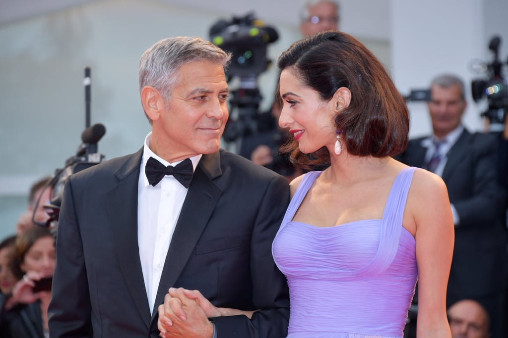 "George and Amal Clooney were the picture of love when they stepped out at the Venice Film Festival on Saturday. Clad in a black tux, George was ever the gentleman as he opened the car door for Amal and led the way for her on the red carpet. To make matters even cuter, the couple exchanged a series of loving looks and held hands as they made their way inside. While the event marked the debut of George's latest film, Suburbicon, it also doubled as the couple's first public appearance since welcoming their twins, Alexander and Ella, back in June.       Related:                                                                                                           How George Clooney's Thoughts on Marriage and Fatherhood Changed Once He Met Amal               Earlier this week, George opened up about how his life has changed since their arrival, telling the Associated Press, ""Right now my job is changing diapers and walking them around a little bit. I really didn't think at 56 that I would be the parent of twins. Don't make plans. You always have to just enjoy the ride. Suddenly, you're responsible for other people, which is terrifying."""