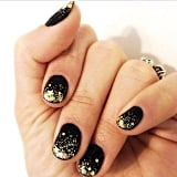 A gorgeously gilded black manicure from celebrity nail artist Stephanie Stone. Source: Instagram user stephstonenails