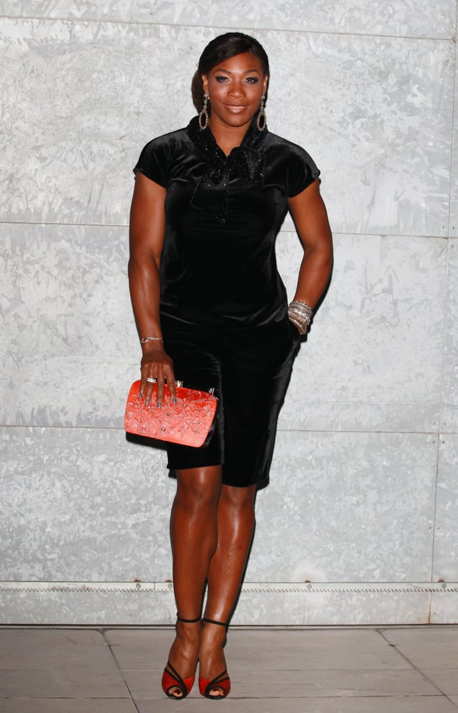 Serena Williams attended the Giorgio Armani show in a cap-sleeved black dress, but finished with a bold-hued clutch and red sandals.