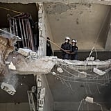 The White Helmets search for victims after an airstrike in Douma.