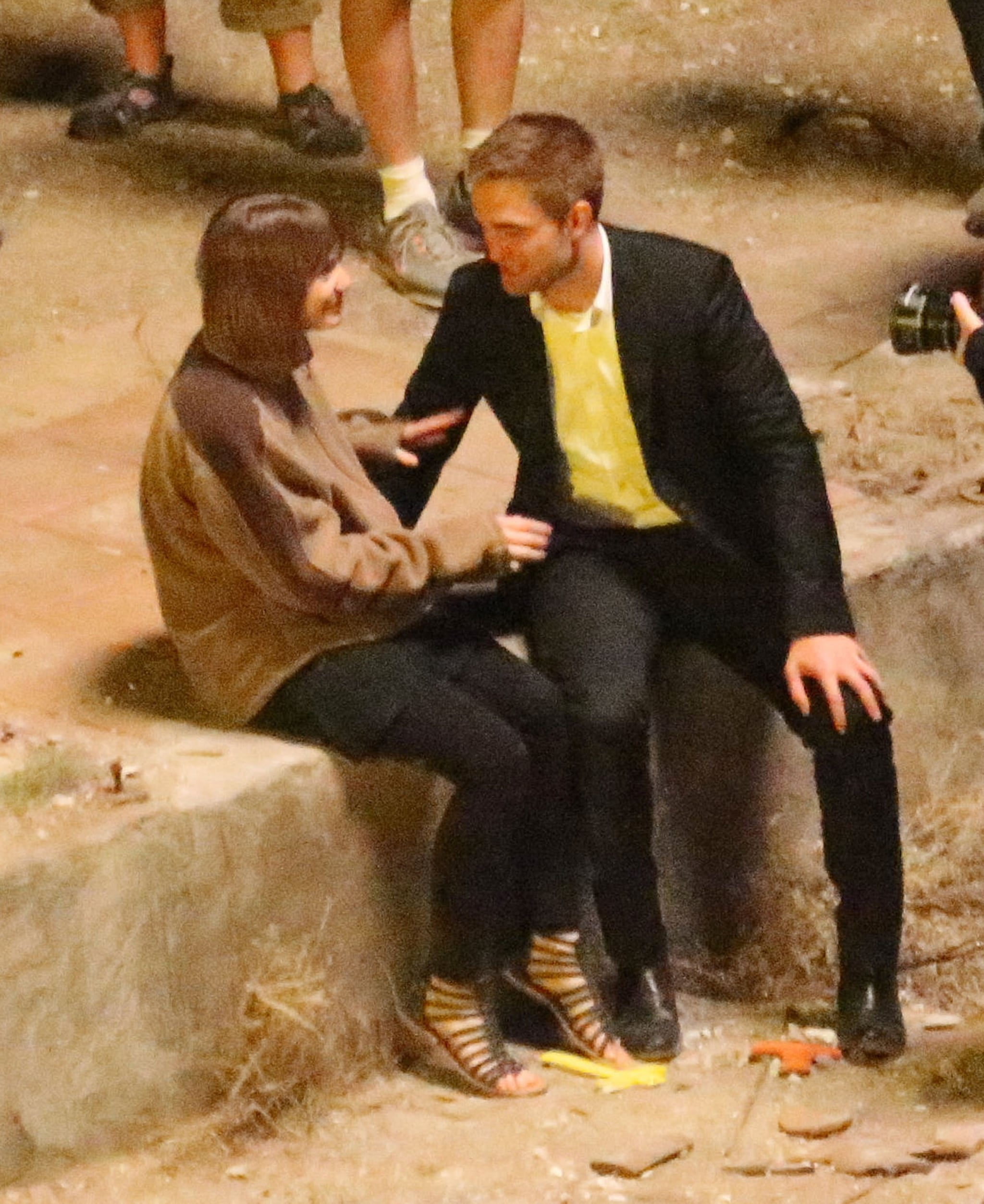 Robert Pattinson chatted with Mia Wasikowska between takes.