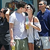 Ashlee Simpson and Vincent Piazza got affectionate in the sun in NYC in July 2011.