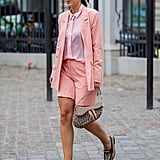 Put a feminine twist on a borrowed-from-the-boys look by choosing contrasting shades of pink for your shorts suit this season.