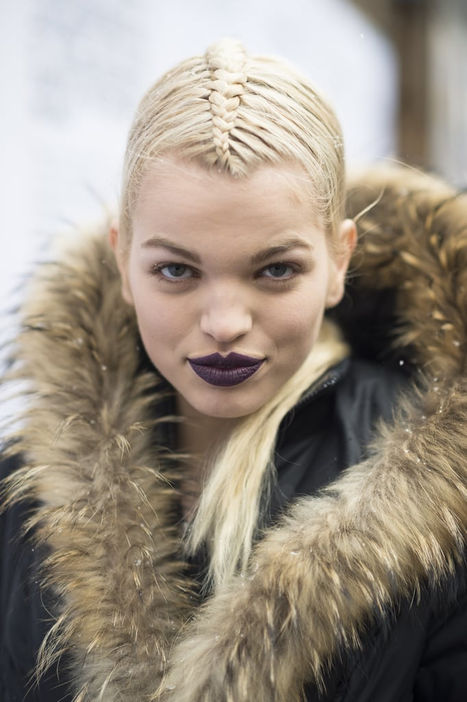 Model Daphne Groeneveld showed off her fierce, hot-off-the-runway look, complete with deep purple lips and a sleek french braid. Source: Le 21ème | Adam Katz Sinding