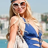 Paris Hilton gave a smile in her blue bathing suit at Bondi Beach in Australia.