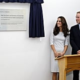 Kate Middleton and Prince William unveil a plaque at the opening of a children's cancer center at the Royal Marsden Hospital.