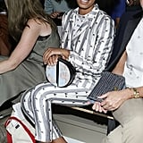 While sitting front row at the Suno show in NYC, Solange worked a classic gray-and-white pinstriped suit, but upon closer inspection, we also spotted little two-toned horses. Her sophisticated clutch doubled as a map and her polished pumps were reminiscent of a childhood favorite: Neapolitan ice cream.