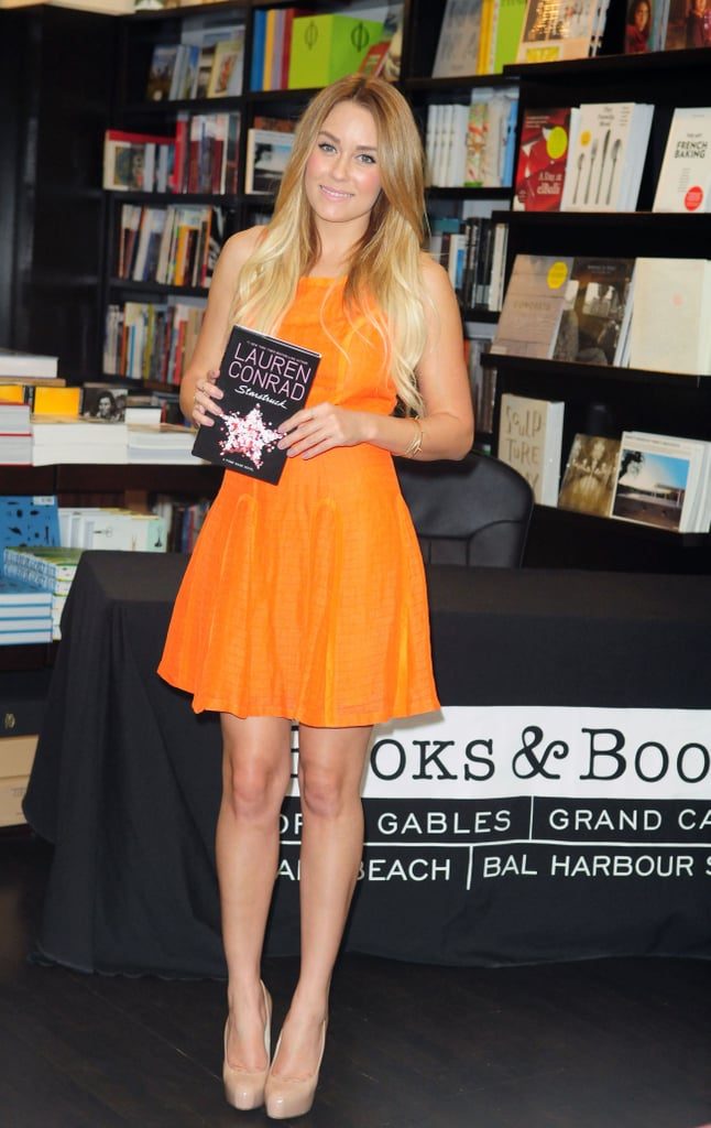 "Lauren Conrad wore a bright orange Harlyn dress to greet fans and sign copies of her latest publications at Books & Books in Bal Harbour, FL, yesterday. This marks the third stop on Lauren's promotional tour for her books Starstruck and Lauren Conrad Beauty, following appearances in NYC and Philadelphia. Although she headed south primarily for work, Lauren was able to fit in some Miami fun, too. Last night, Lauren enjoyed a night out, tweeting, ""Just ordered a drink called 'The Spice of Love.' I'm really living it up in Miami!"" Speaking of love, Lauren made her red carpet debut with boyfriend William Tell last week when she hosted the Susan G. Komen Foundation's Designs For the Cure gala in LA."