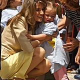 Princess Letizia gave a little girl a big hug during a visit to the Baleares Islands in May 2005.