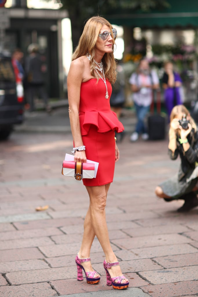 Anna Dello Russo kept to her signature style formula: bold minidress + even bolder accessories. Source: Greg Kessler