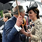 Prince Charles and Kate stopped in the rain to great each other with smiles in 2016.