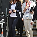 On Monday 30 July, Kate watched the equestrian events in Greenwich Park in a white Team GB shirt, navy Smythe blazer and Stuart Weitzman wedges.
