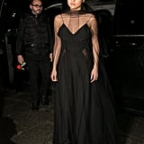 Selena's gorgeous Vionnet gown was semisheer, complete with an elegant overlay. The delicate spaghetti straps stood out from underneath her look, and her outfit was capped with a pair of Christian Louboutin heels when she stepped out in Paris for a Louis Vuitton dinner in 2016.