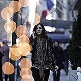 Karen strolls NYC in a super-fierce fringed scarf.