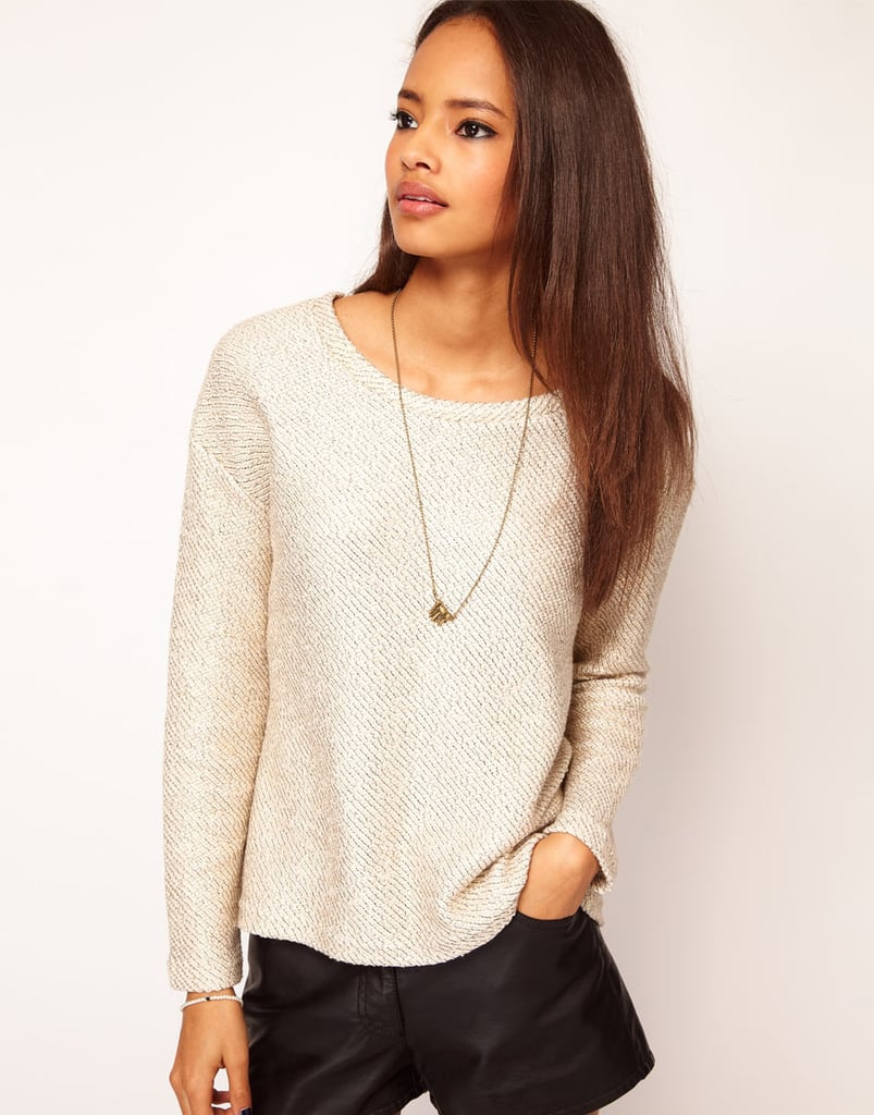 Pair this boatneck sweater with a skirt or leather shorts. ASOS Sweater in Metallic Cut and Sew  ($43)