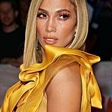 Jennifer Lopez Wears Yellow Gown to Hustlers TIFF Premiere