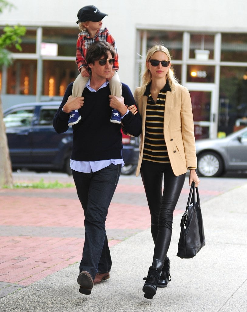 While walking around NYC with her family, Karolina Kurkova mixed stripes with her sneakers, and added leather leggings for even more edge.