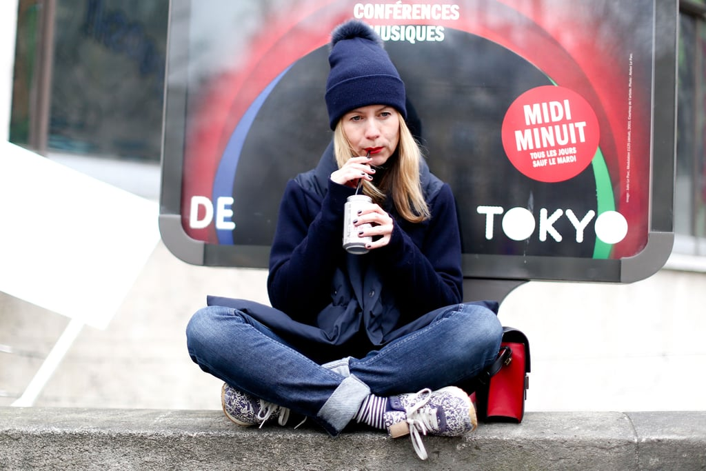 Natalie Joos worked a casual combination in a navy beanie and printed kicks.