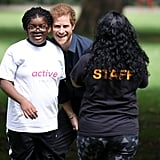 Prince Harry Gives a Group of Kids a Good Rough and Tumble During a Charity Visit