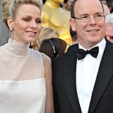 Prince Albert and Charlene Whitstock smile at the academy awards