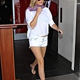 Kate Hudson brings on her signature bohemian flair with a loose printed scarf and sandals.