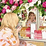 POPSUGAR: So today is all about fragrance — tell me a little bit about how you wear it. Are you the spritz-on-your-wrist or walk-into-it person? Reese Witherspoon: I'm definitely spray in the air and walk through it — two, three times. Forward. Back. Forward. Out. PS: Do you have specific scent memories that are linked to particular perfumes? RW: Perfume reminds me of my grandmother. She always loved beautiful floral fragrances like rose and gardenia, and my mother was the same. I remember all the bottles lined up on her dresser and just thinking she was so feminine and gorgeous. PS: Do you remember when you first started wearing perfume and what you wore? RW: I do, actually. I think the first perfume I ever bought was Betsey Johnson. Doesn't that just say that I grew up in the '90s?  PS: Totally. Tell me about your title with Elizabeth Arden as storyteller-in-chief. Can you talk about the role that storytelling has played in your own life? RW: It's all I ever wanted to be when I was little. I loved reading. I loved books. I just loved telling other people's stories. The fact that I've been able to transform my life and be a storyteller for as long as I have, and now have the opportunity to help women get their stories made into film and television, [is] just really a dream come true.