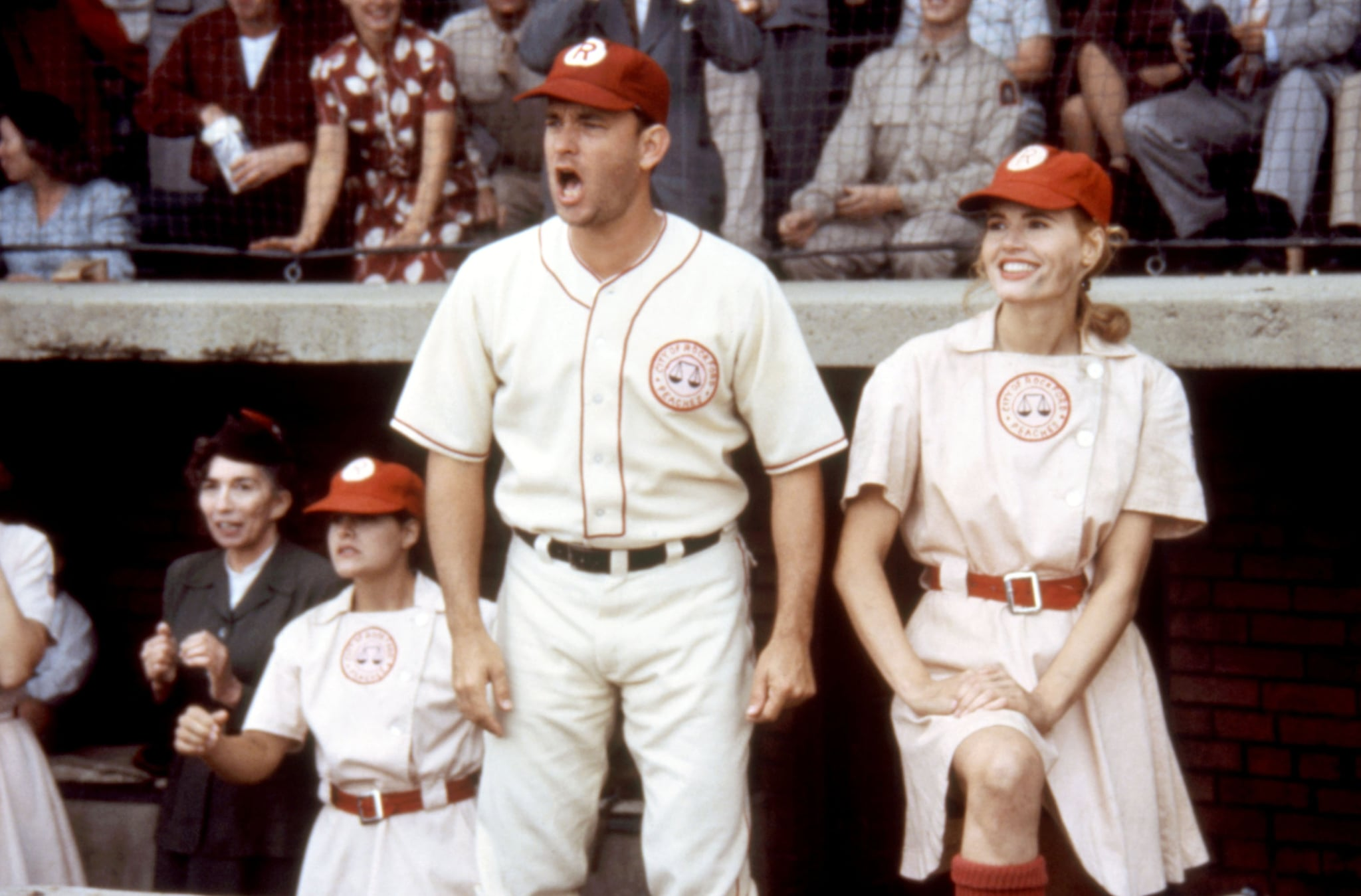 A LEAGUE OF THEIR OWN, foreground: Tom Hanks, Geena Davis, 1992.  Columbia Pictures/ Courtesy Everett Collection.