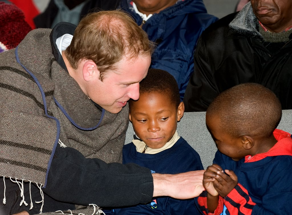 Prince William chatted and played with two young boys during a June 2010 trip to a children's center in South Africa.