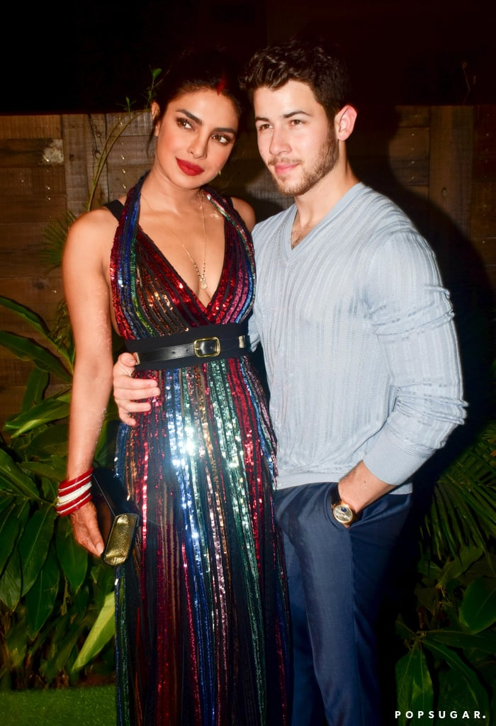 Priyanka Chopra was shining and shimmering at a Bumble launch party in Mumbai on Dec. 7, and not just because of her newlywed glow. While the Quantico actress stunned with her husband Nick Jonas by her side, it was her sparkling gown that really stole the show.  The glittery Elie Saab number featured a plunging neckline, a belted waistband, and multicoloured sequins with hints of sheer lace. Priyanka let the statement halter dress speak for itself and finished off the ensemble with minimal accessories, including a thin gold chain necklace, red bracelets, and a black clutch. Check out another snap of her look below and make sure to stay up to date on all the jaw-dropping outfits she chose for her wedding.       Related:                                                                                                           Priyanka Chopra's Heels Are Like a Modern-Day Cinderella's Glass Slippers