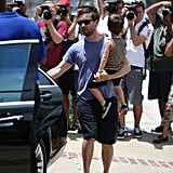 Tobey Maguire carried his son Otis to a Memorial Day beach party in Malibu, CA, on Monday.