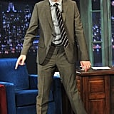 Robert Pattinson wore a striped tie for the show.