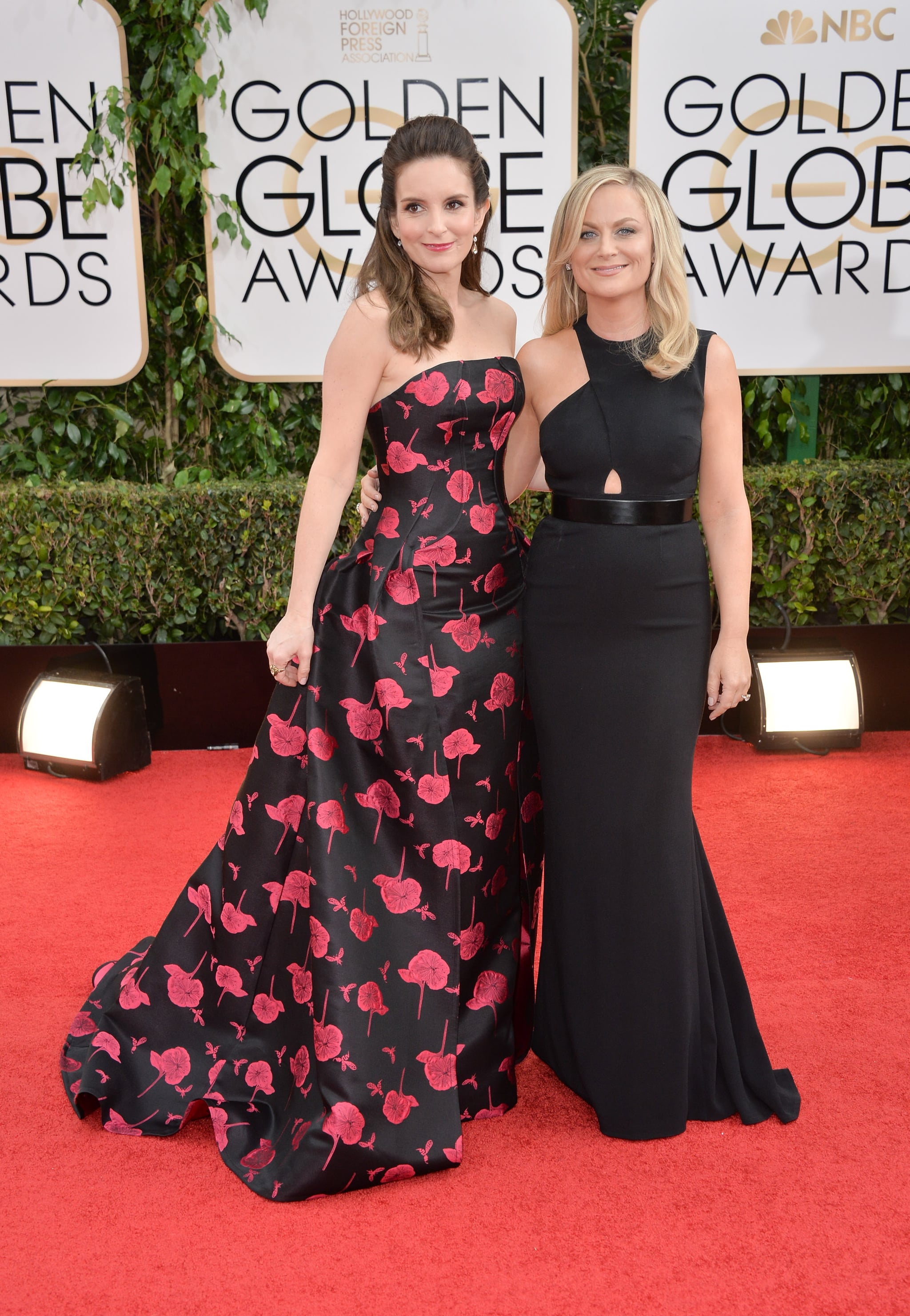 BEVERLY HILLS, CA - JANUARY 12:  Actresses Tina Fey (L) and Amy Poehler attend the 71st Annual Golden Globe Awards held at The Beverly Hilton Hotel on January 12, 2014 in Beverly Hills, California.  (Photo by George Pimentel/WireImage)
