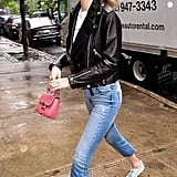When Burberry launched its new signature DK88 bag in May 2017, Gigi, of course, was one of the first to get her hands on one. The mini accessory added a ladylike touch to her casual outfit, which consisted of a leather jacket, cropped Black Orchid denim, and a Fiorucci t-shirt.
