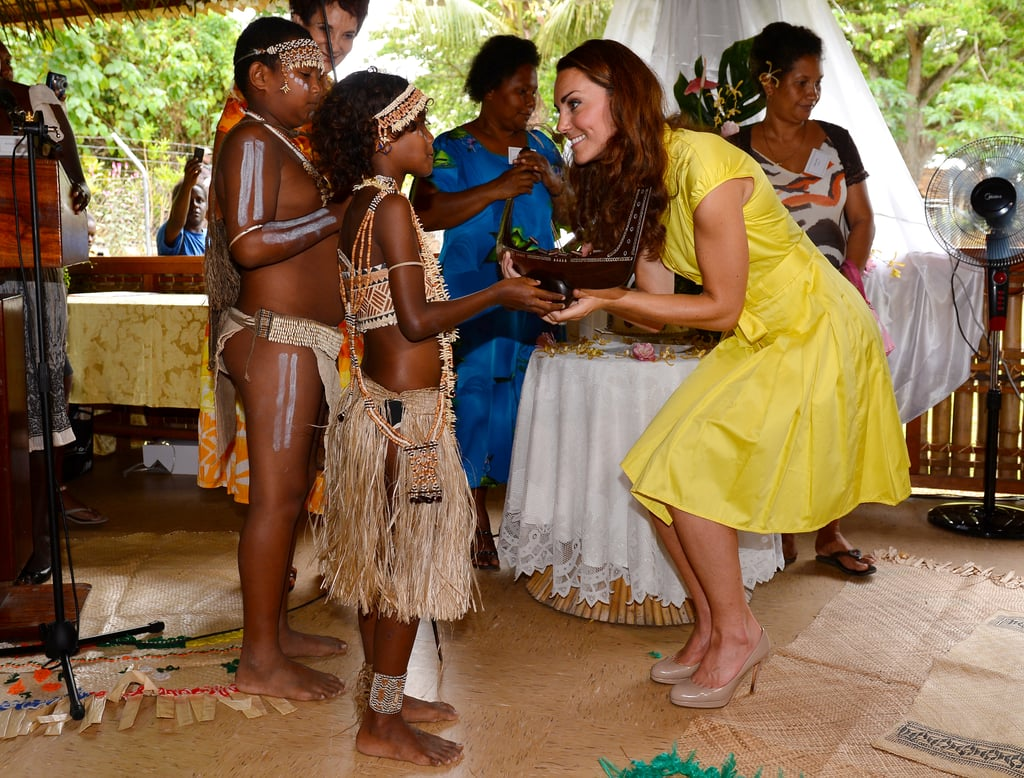 Kate looked so excited to be presented with a small canoe by local children in the Solomon Islands. She and William made a stop in the country's capital during their Diamond Jubilee tour in September 2012.