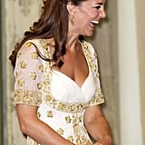 Kate carried a matching gold clutch.