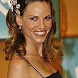 Hilary Swank added a touch of sparkle to some retro waves at a Golden Globes party.