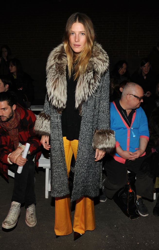 Styling a fur-trim cardigan coat with flared orange trousers at the Creatures of the Wind show, Dree Hemingway took a page straight from the '70s.