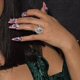 Honestly Wondering How the Giant Jewels on Her Middle Finger Stayed Put