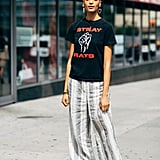 Style a Red and Black Graphic Tee With Printed Pants