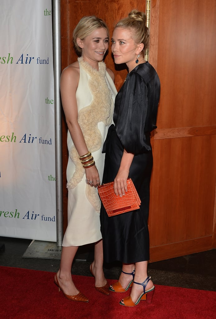 Mary-Kate Olsen and Ashley Olsen wore their brand, The Row, dresses for the Fresh Air Fund's Spring Gala in NYC.