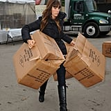 Jessica Biel carried cardboard boxes while volunteering.