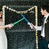 Let's be honest: a Star Wars wedding can be tricky. You want it to be over-the-top fun, but you also run the risk of making it feel like a kids' party. POPSUGAR Tech is here to help! Ahead, check out everything you need — from starry invites to a lightsaber send-off — to keep your big day classy and memorable at the same time. Photos by Meg Ruth Photo via Green Wedding Shoes